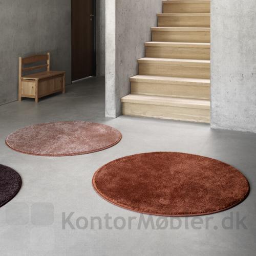 Epoca Moss tæppe med rund form, giver liv til rummet